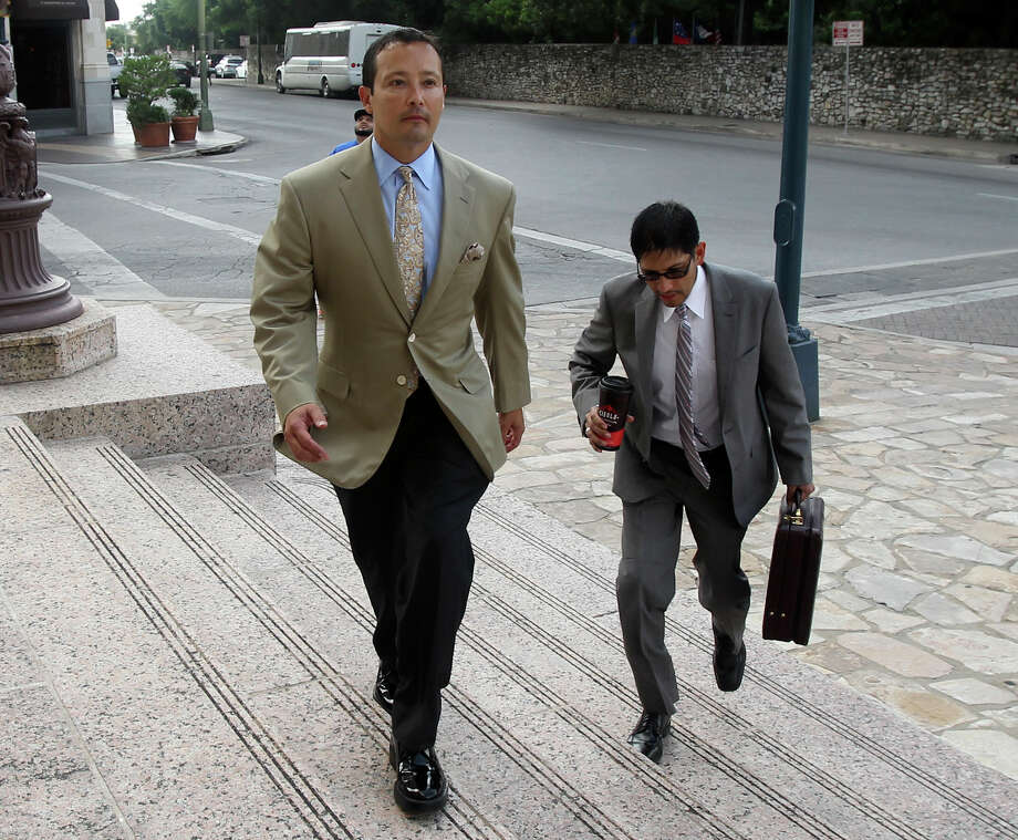 Bankrupt Primera Energy LLC owner Brian Alfaro (left) approaches the Hipolito F. Garcia Federal Building and U.S. Court House on Thursday to attend a court hearing. Photo: John Davenport /San Antonio Express-News / ©San Antonio Express-News/John Davenport