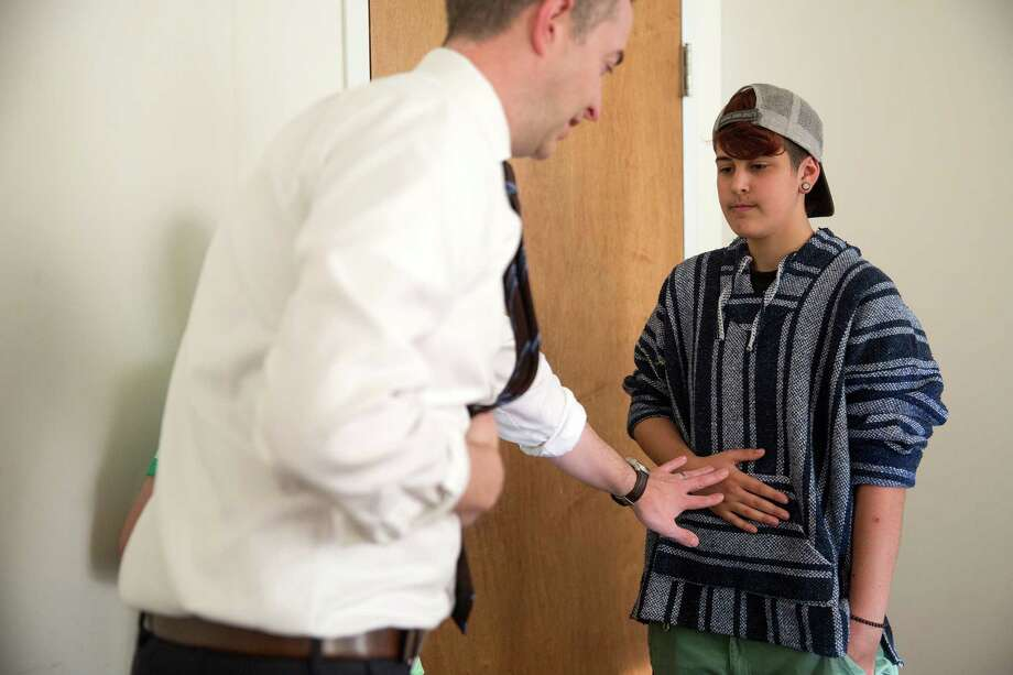 Nathan Waller, an instructor with Northwestern University's Center for Audiology, Speech, Language and Learning, left, does a breathing exercise with Jay Luciano, 15, in a vocal training class with other transgender students at the administrative offices of Lurie Children's Hospital's Division of Adolescent Medicine in Chicago on Monday, June 1, 2015. Photo: Erin Hooley /McClatchy-Tribune News Service / Chicago Tribune
