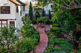 A view from above the home's side courtyard and brick walkway.