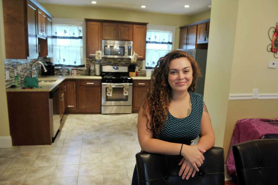 Home owner Kerri Kenyon poses for a photograph inside her home on Monday, July 6, 2015, in Troy, N.Y.   (Paul Buckowski / Times Union) Photo: PAUL BUCKOWSKI / 00032469A
