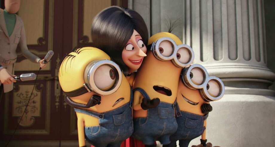 "In this image released by Universal Pictures, Scarlet Overkill, voiced by Sandra Bullock, second left, appears with minions Stuart, left, Kevin and Bob, right, in a scene from the animated feature, ""Minions."" (Illumination Entertainment/Universal Pictures via AP) ORG XMIT: NYET116 Photo: Illumination Entertainment / Universal Pictures"