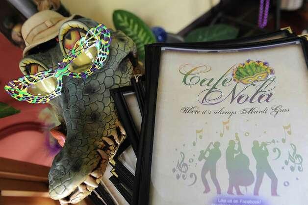 An alligator and menus at Cafe Nola on Thursday, July 2, 2015 in Schenectady, N.Y. (Lori Van Buren / Times Union) Photo: Lori Van Buren / 00032452A