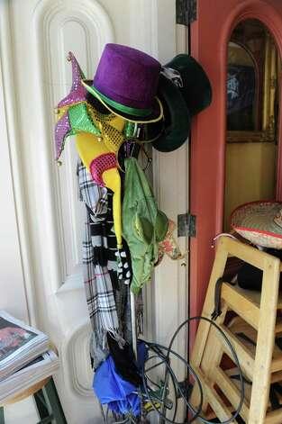 Mardi Gras clothing hangs on a coat rack at Cafe Nola on Thursday, July 2, 2015 in Schenectady, N.Y. (Lori Van Buren / Times Union) Photo: Lori Van Buren / 00032452A
