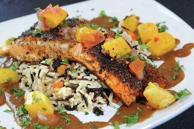 Blackened salmon with mango salsa at Cafe Nola on Thursday, July 2, 2015 in Schenectady, N.Y. (Lori Van Buren / Times Union) Photo: Lori Van Buren / 00032452A