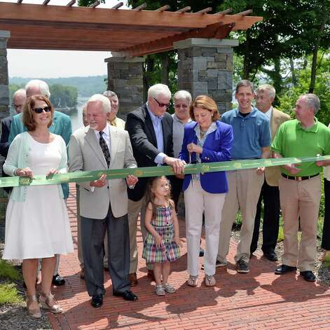 Mayor Joanne Yepsen, center, cuts a ribbon re-opening Waterfront Park on Saratoga Lake Thursday July 9, 2015 in Saratoga Springs, NY.  (John Carl D'Annibale / Times Union) Photo: John Carl D'Annibale / 00032542A