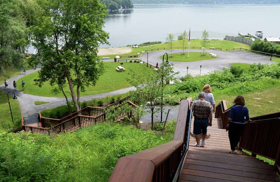 Visitors walk down steps from a parking lot to the newly re-opened Waterfront Park on Saratoga Lake Thursday July 9, 2015 in Saratoga Springs, NY.  (John Carl D'Annibale / Times Union) Photo: John Carl D'Annibale / 00032542A