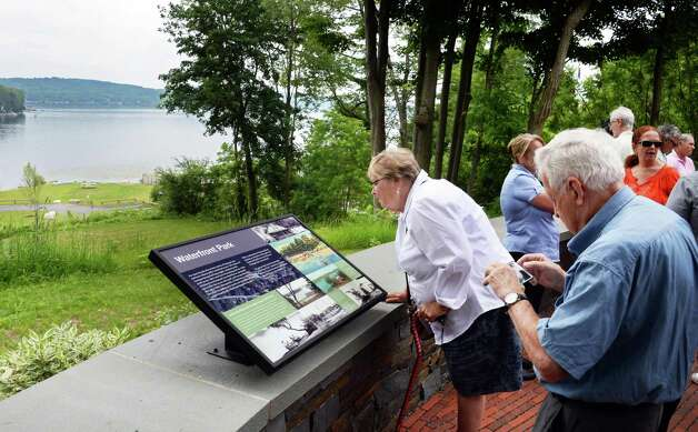 Denise Hughes, center, of Saratoga Springs examines an historic marker during a ceremony re-opening Waterfront Park on Saratoga Lake Thursday July 9, 2015 in Saratoga Springs, NY.  (John Carl D'Annibale / Times Union) Photo: John Carl D'Annibale / 00032542A