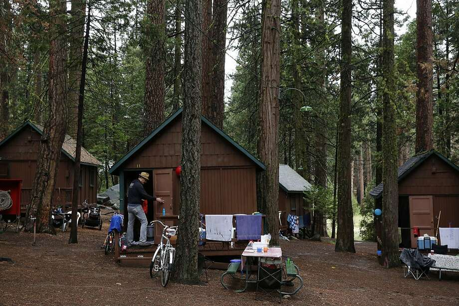 David Radke cleans up the porch area of his family's cabin July 9, 2015 at Mather Family Camp in Groveland, Calif.  Photo: Leah Millis, The Chronicle