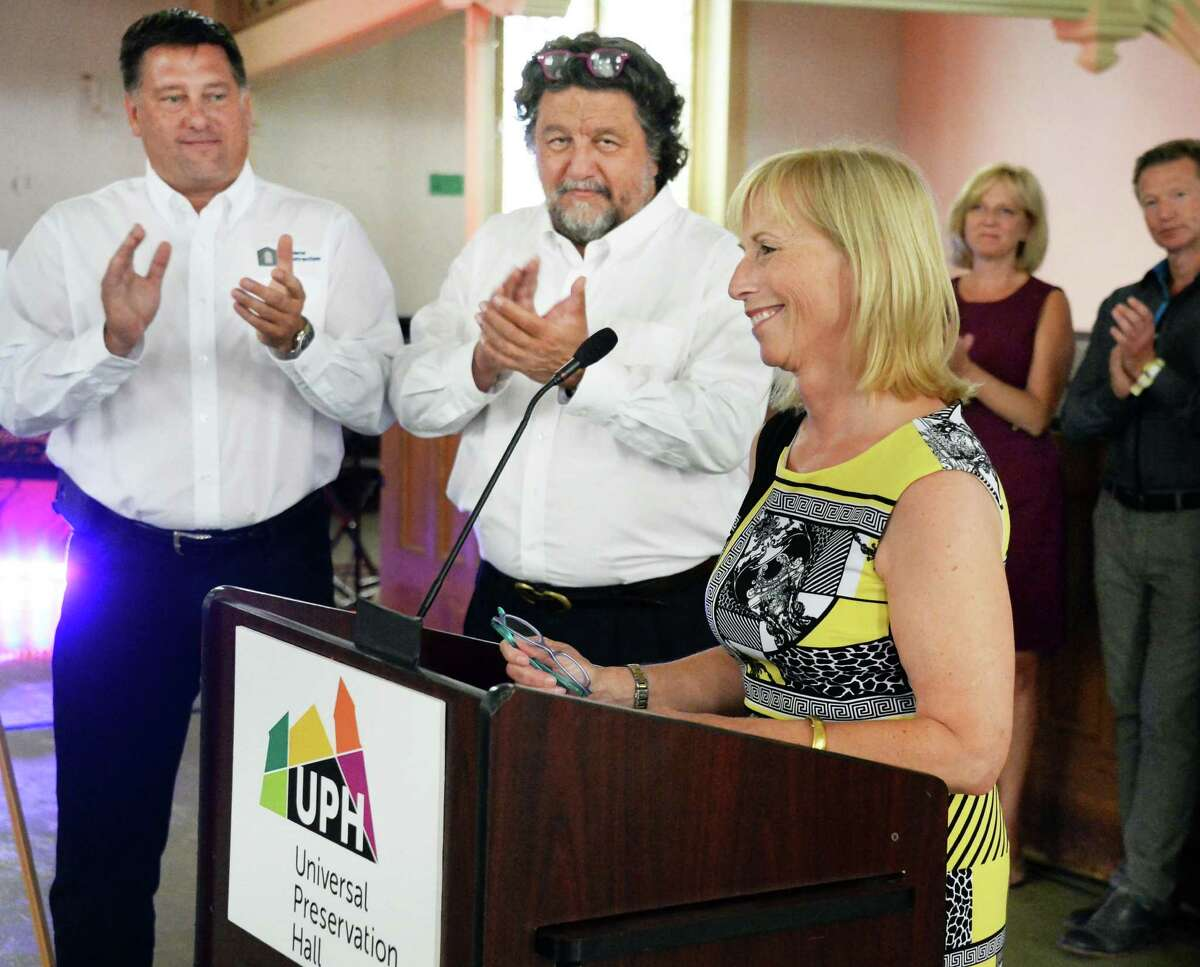 Bonacio Construction's Sonny Bonacio, left, and Proctor's CEO Philip Morris applaud as UPH president Teddy Foster, right, announces a joint future Universal Preservation Hall and Proctors arts partnership Thursday July 9, 2015 in Saratoga Springs, NY. (John Carl D'Annibale / Times Union)