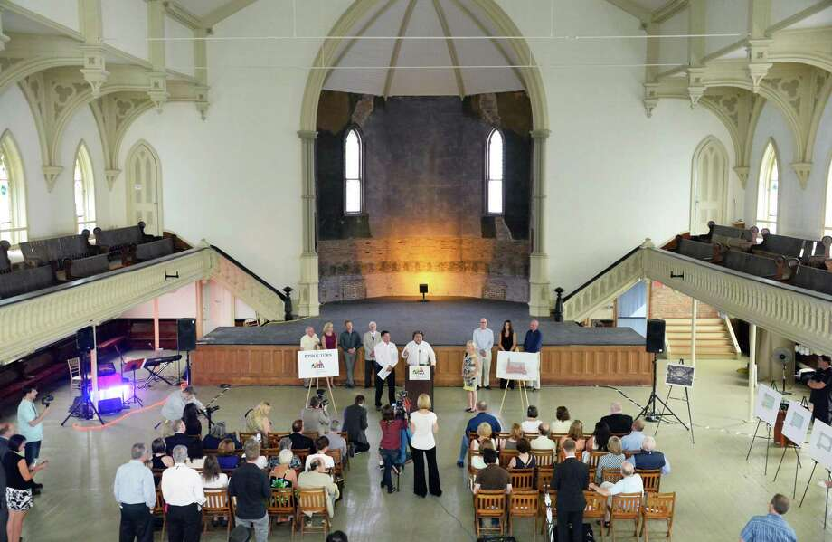 Proctor's CEO Philip Morris, center at podium, announces a joint future Universal Preservation Hall and Proctors arts partnership Thursday July 9, 2015 in Saratoga Springs, NY.  (John Carl D'Annibale / Times Union) Photo: John Carl D'Annibale / 00032535A