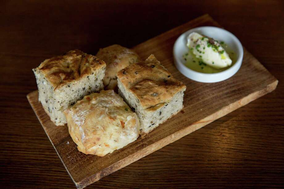 Cheddar bacon onion biscuits and olive focaccia bread exemplify the focus on Texas products at Antlers Lodge. Photo: Ray Whitehouse /San Antonio Express-News / 2015 San Antonio Express-News