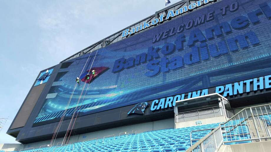 A crew from Stamford, Conn.-based Sentinel Maintenance cleans the LED video display at Bank of America Stadium in Charlotte, N.C. Photo: Contributed Photo / Hearst Connecticut Media / Stamford Advocate