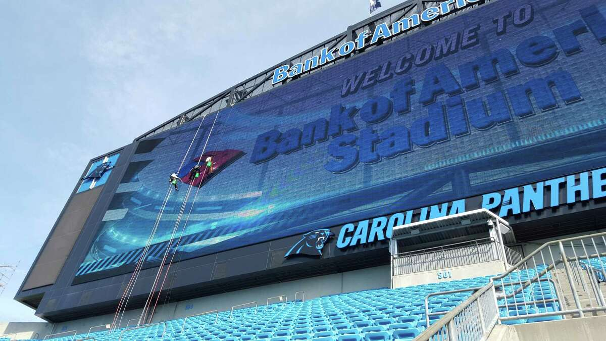 A crew from Stamford, Conn.-based Sentinel Maintenance cleans the LED video display at Bank of America Stadium in Charlotte, N.C.