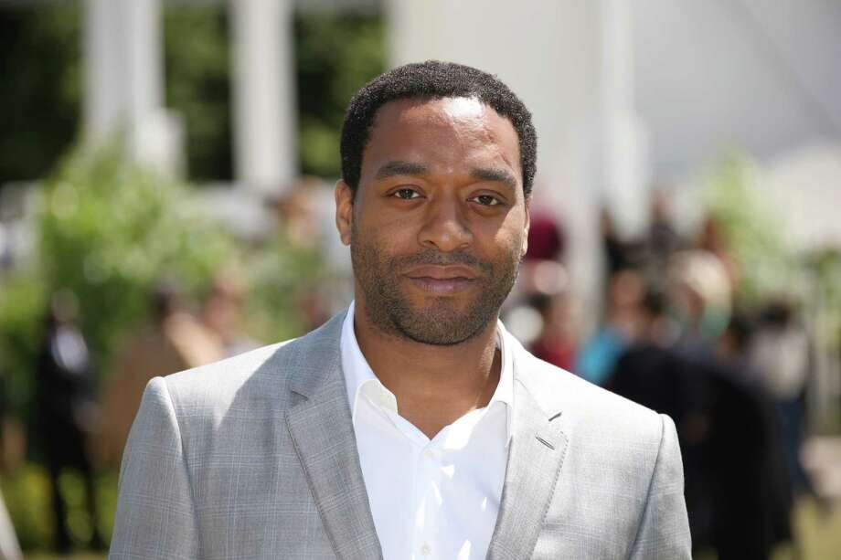 Chiwetel Ejiofor poses for photographers upon arrival at the Burberry Prorsum menswear Spring Summer fashion show in London, Monday, 15 June, 2015. (Photo by Joel Ryan/Invision/AP) ORG XMIT: LENT116 Photo: Joel Ryan / Invision