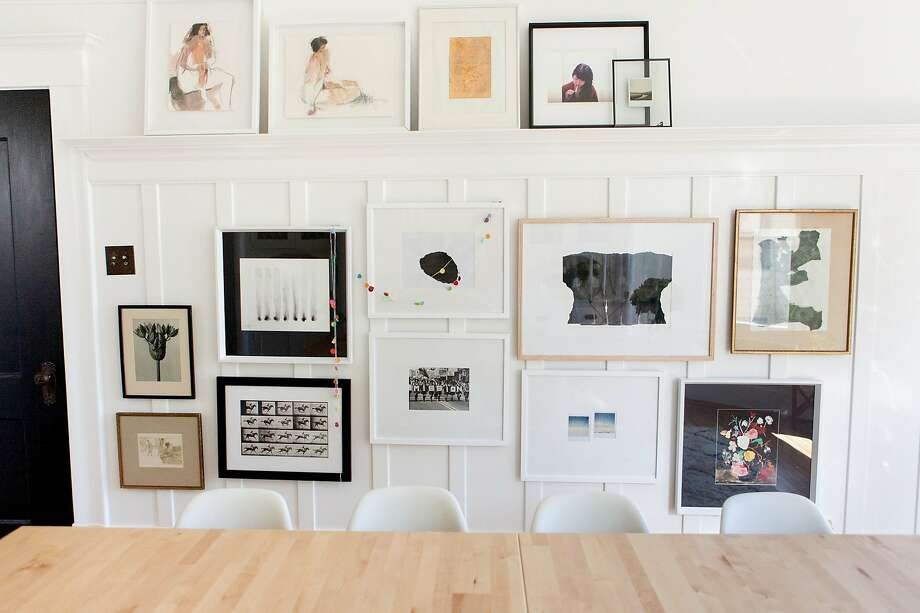 Jordan and Paul Ferney arrange framed art salon-style in the dining room of their S.F. flat. Photo: Paul Ferney
