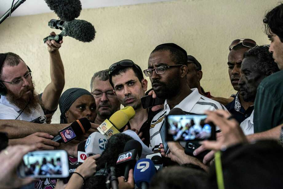 Relatives of Ethiopian-Israeli Avraham Mengisto, 28, hold a press conference in the costal city of Ashkelon, Israel, Thursday, July 9, 2015. An Israeli security official said Thursday the Hamas militant group has been holding Mengisto in the Gaza Strip for nearly a year. The Israeli defense body responsible for Palestinian civilian affairs, said Mangisto, born in 1986 from the Israeli city of Ashkelon, independently crossed the border fence into the Gaza Strip in September last year, nearly two weeks after the end of the Israel-Gaza war. (AP Photo/Tsafrir Abayov) Photo: Tsafrir Abayov, STR / AP