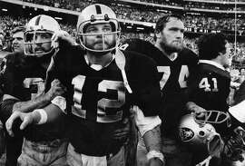 Dec. 17, 1978: Kenny Stabler staggers off the field with his teammates after scoring a game-winning rushing touchdown against the Minnesota Vikings.