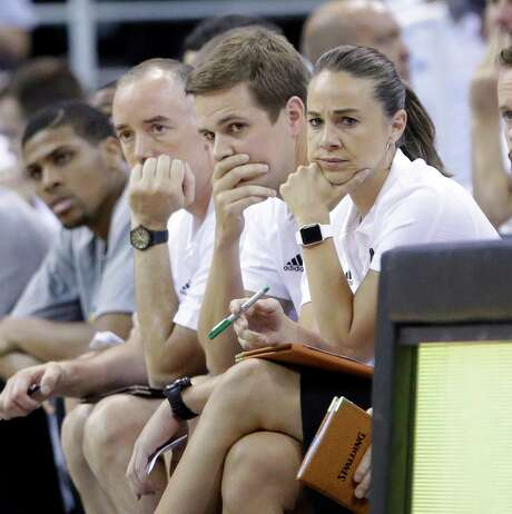 In this Monday, July 6, 2015, photo, San Antonio Spurs summer league head coach Will Hardy, center, assistant coaches Becky Hammon, right, and Ken McDonald, second from left, looking on during the second half of an NBA summer league basketball game against the Philadelphia 76ers, in Salt Lake City. (AP Photo/Rick Bowmer) Photo: Rick Bowmer, STF / Associated Press / AP