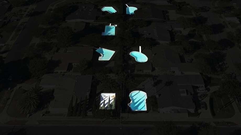 """Pools,"" Masood Kamandy; high-definition video and sculpture, six minutes looped. The aerial imagery shows pools glowing like phosphorescent amoebas. Photo: Masood Kamandy, Luis De Jesus Los Angeles."