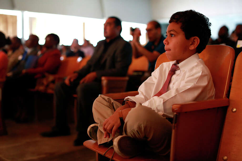 "Ron Kelley Jr., 6, the son of speaker Dr. Ron Kelly, watches as Mayor Ivy Taylor speaks during the ""My Brother's Keeper"" event at Sam Houston High School in San Antonio on Thursday, July 9, 2015. The senior Kelley is the the CEO of The National School Improvement Corporation. Photo: Lisa Krantz, Staff / SAN ANTONIO EXPRESS-NEWS / SAN ANTONIO EXPRESS-NEWS"
