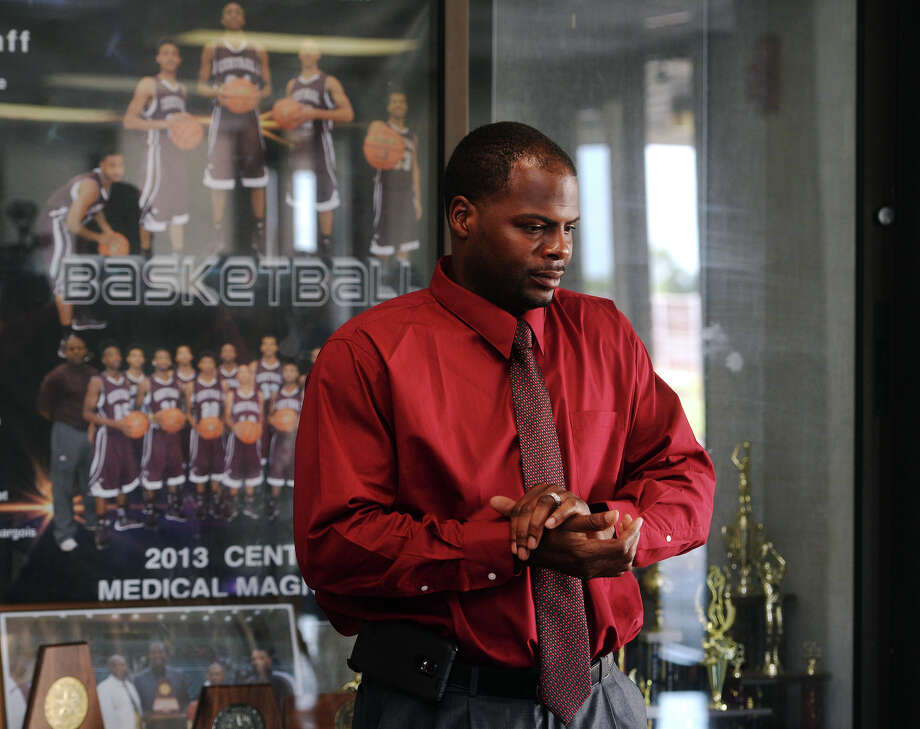 Franklin Paul stands near the Central High School trophy case before a short press conference Thursday. The Beaumont Independent School District announced the appointment of Franklin Paul to the position of varsity basketball coach for Central Medical Magnet High School on Thursday afternoon. Paul was an assistant coach last year and will be replacing Robert Lee. Photo taken Thursday 7/9/15 Jake Daniels/The Enterprise Photo: Jake Daniels / ©2015 The Beaumont Enterprise/Jake Daniels