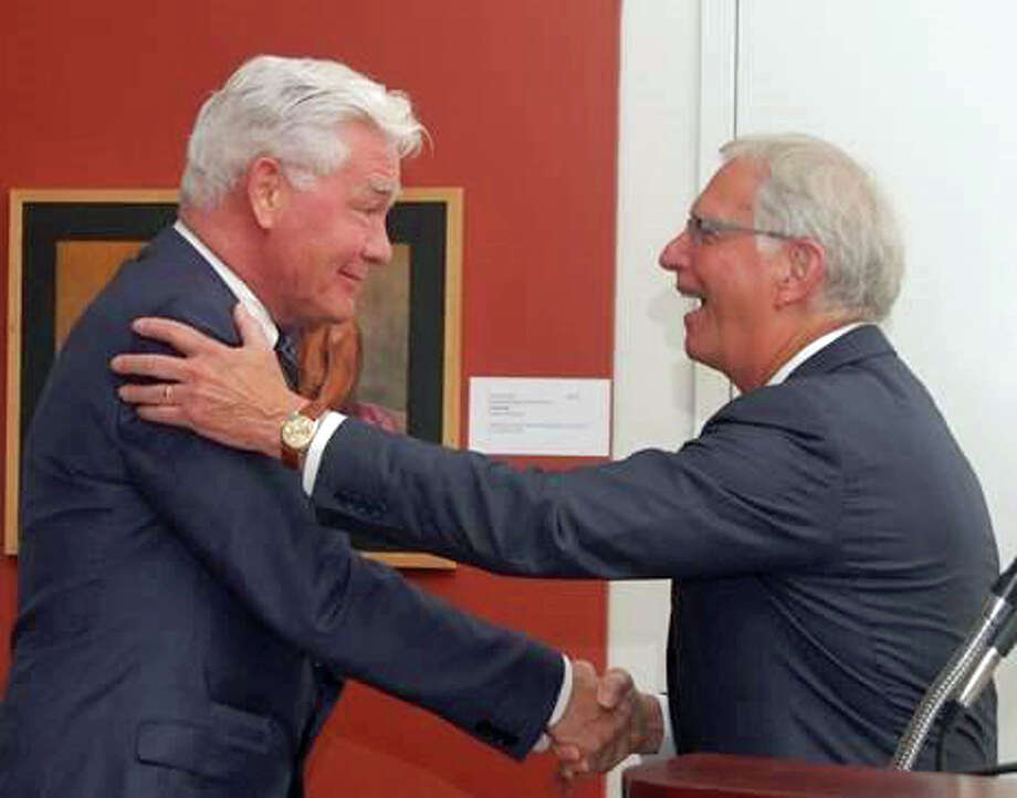(from left) Bruce Museum Executive Director Peter C. Sutton receives the 2015 Chairmanís Award from Chairman of the Board Robert H. Lawrence, Jr. at the Museumís annual meeting in June. The Bruce Museum elected nine new members to their Board of Trustees, and re-elected seven Trustees. Photo: Contributed / Contributed Photo / Greenwich Time Contributed