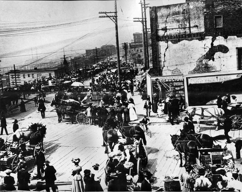 A look north on Pike Place from its intersection with Pike Street, as pictured in 1907.