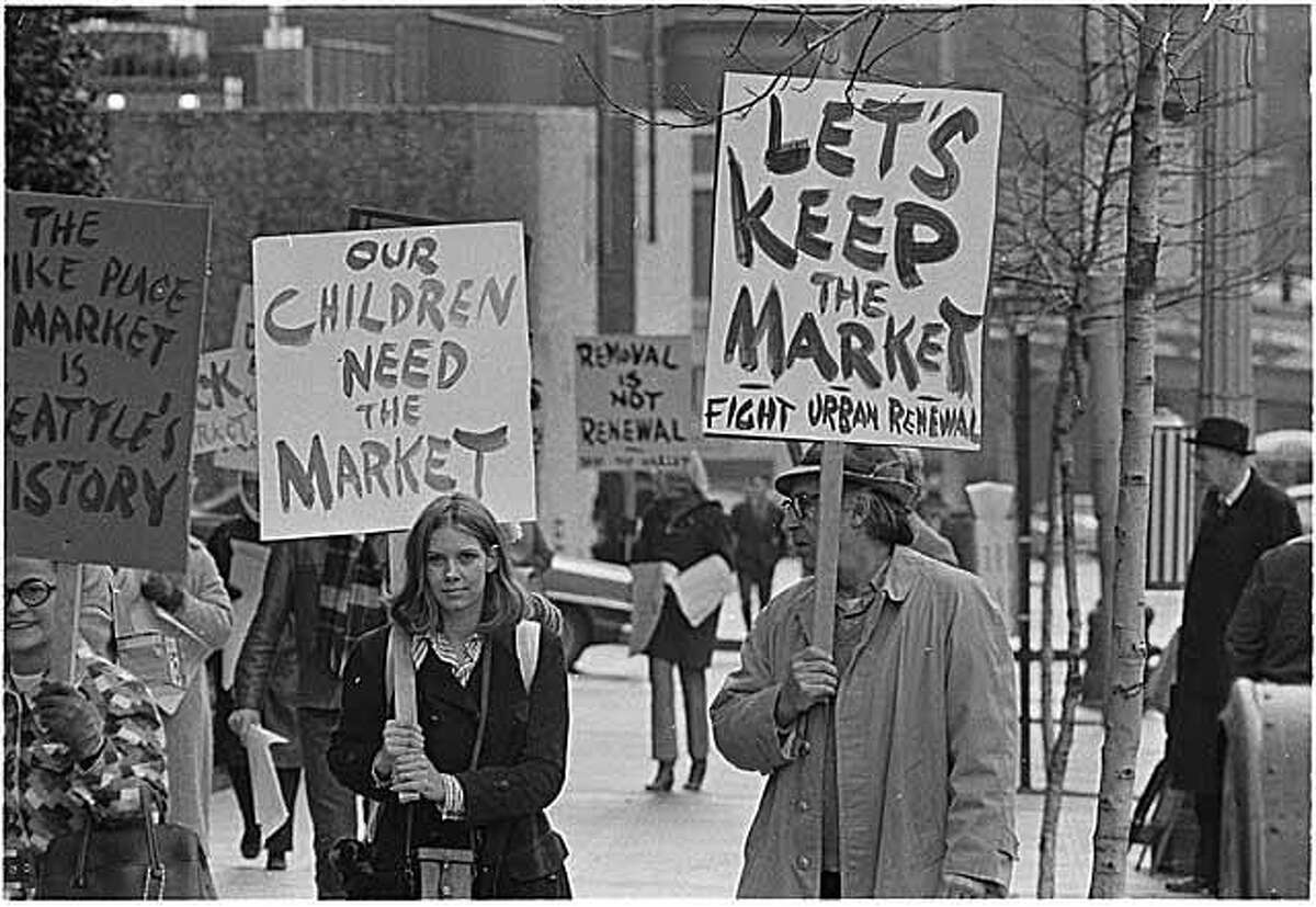 Demonstrators protest the proposed demolition of Pike Place Market. A citizen initiative opposing Seattle City Council plans to replace the market with highrises won out, saving the market. Photo by Seattle Post-Intelligencer photographer Timothy Eagan. Keep clicking for photos of Pike Place Market through the years...