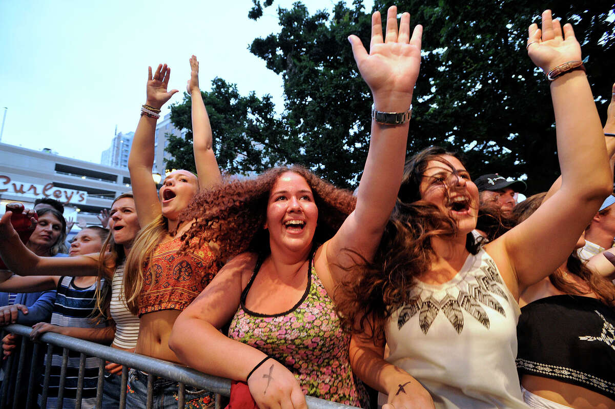 From right: Esin Saracoglu, Eleni Partaki, Sophia Bourgeois, and Claire Price react to Michael Franti and Spearhead performing during Alive@Five in Columbus Park in Stamford, Conn., on Thursday, July 9, 2015. The concerts begin at 5 p.m. and run for six Thursdays, July 9 - August 13. Hearst Connecticut Media is a sponsor of the event. Esin and Eleni are both from Cyprus and are taking part in the Cyprus Friendship Program, a reunification program meant to bring North and South Cyprus together in peace.