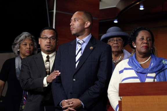 Black Caucus members, from left, Joyce Beatty, D-Ohio, Keith Ellison, D-Minn., Hakeem Jeffries, D-N.Y., Alma Adams, D-N.C., and Sheila Jackson Lee, D-Houston, show support  for a resolution to remove the Confederate flag on federal lands.