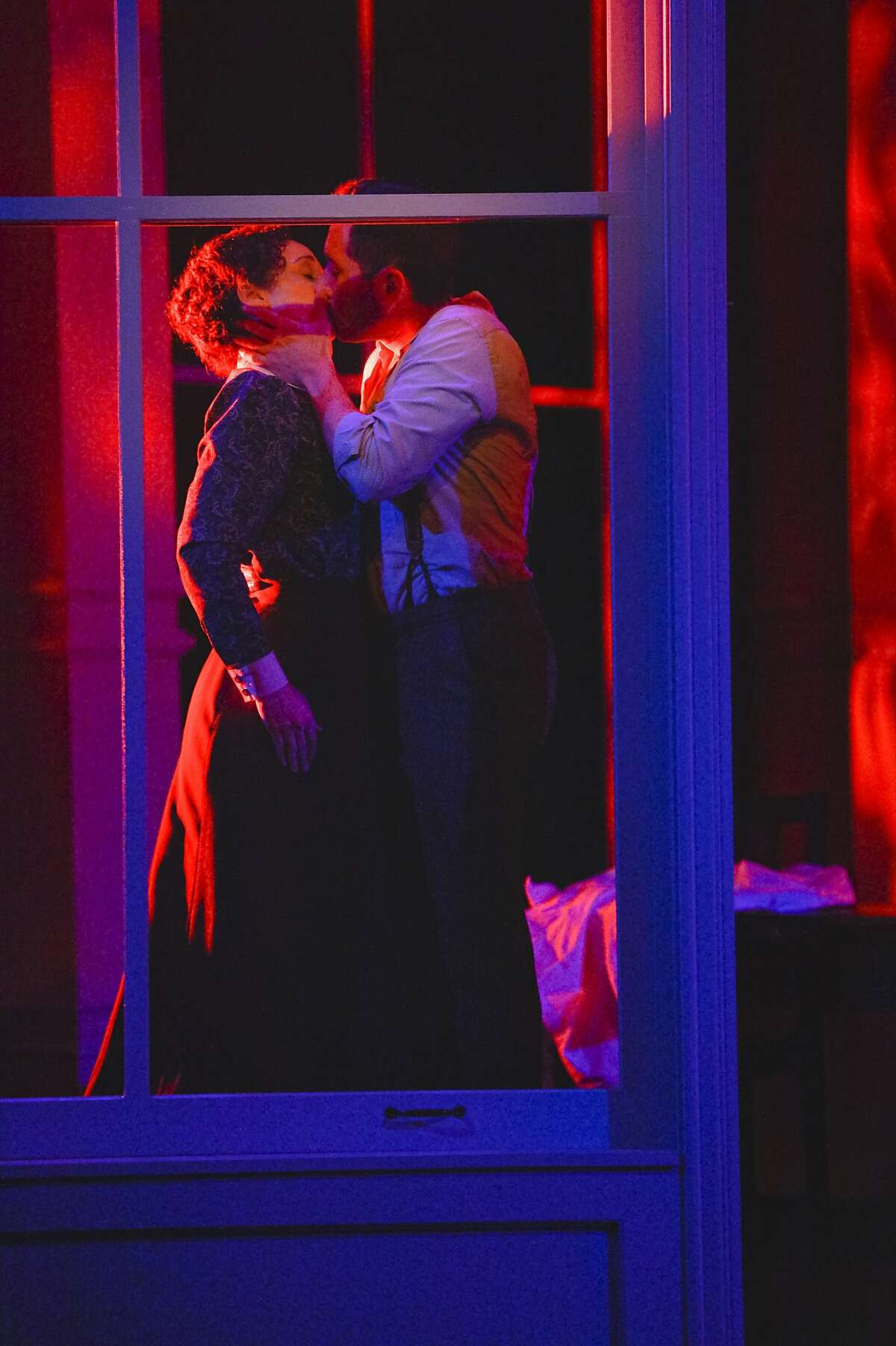 TheatreWorks_Triangle 17_KevinBerne: Sarah (Megan McGinnis) and Vincenzo (Zachary Prince) share a final kiss in TheatreWorks Silicon Valley's World Premiere of Triangle playing July 8 - August 2 at the Lucie Stern Theatre in Palo Alto.