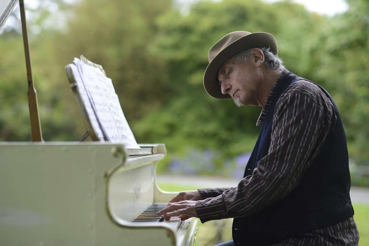 Dean Mermell plays one of the seven pianos located in the San Francisco Botanical Gardens in San Francisco, California, on Thursday, July 9, 2015.