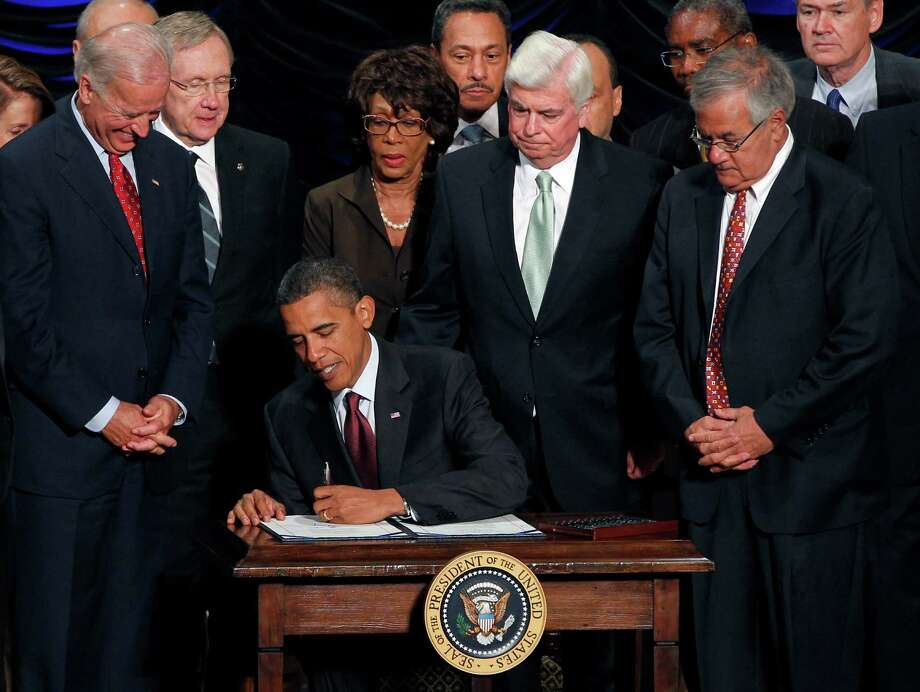 FILE- In this July 21, 2010 file photo, President Barack Obama signs the Dodd-Frank Wall Street Reform and Consumer Protection financial reform bill at the Ronald Reagan Building in Washington. Standing behind Obama, from left, Vice President Joe Biden, Senate Majority Leader Harry Reid D-Nev., Rep. Maxine Waters, D-Calif., Rep. Mel Watt, D-N.C., Sen. Chris Dodd, D-Conn., Rep. Gregory Meeks, D-N.Y., Rep. Barney Frank, D-Mass, and Rep. Dennis Moore, D-Kan. Six years after the collapse of Lehman Brothers, the lessons of the financial crisis may already be fading from memory. (AP Photo/Charles Dharapak, File) Photo: Charles Dharapak / Associated Press / AP