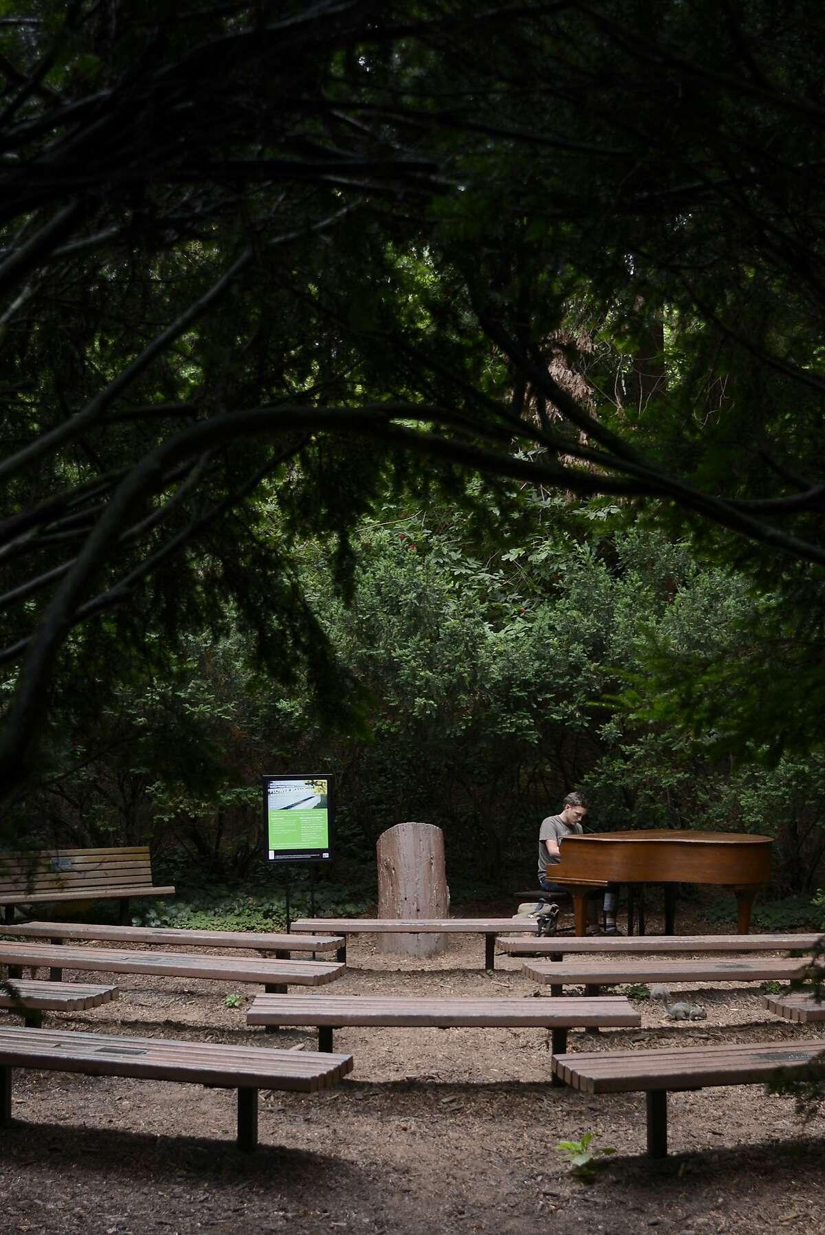 Reese Kolar plays one of the seven pianos at the San Francisco Botanical Gardens in San Francisco, California, on Thursday, July 9, 2015.
