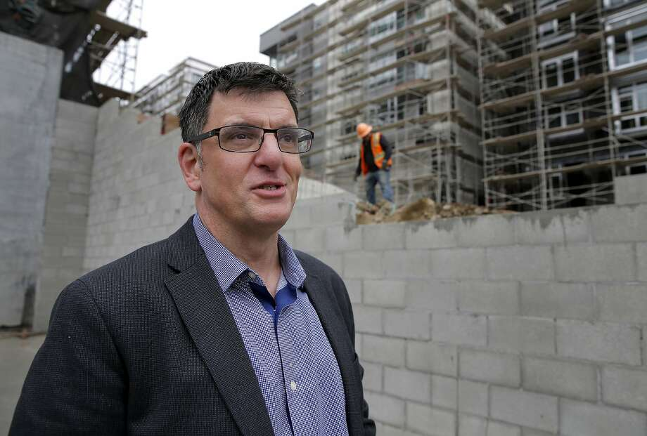 Seth Kilbourn, executive director of Openhouse, stands in the location of a future housing development that will have units targeting low-income LGBT seniors in the Castro neighborhood of San Francisco, California, on Thursday, July 9, 2015. Photo: Connor Radnovich, The Chronicle