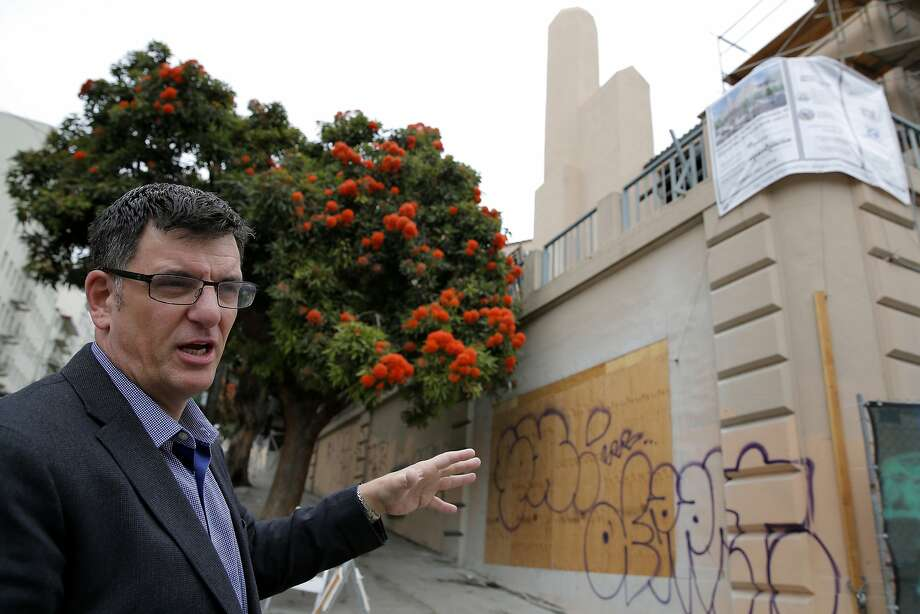 Seth Kilbourn, executive director of Openhouse, describes a future housing development from outside the location in the Castro neighborhood of San Francisco, California, on Thursday, July 9, 2015. Photo: Connor Radnovich, The Chronicle