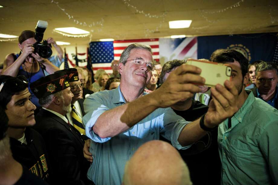 Jeb Bush takes a photo with attendees at a campaign event at a VFW post in Hudson, N.H., on Thursday after his campaign allies raised a record amount.  Photo: IAN THOMAS JANSEN-LONNQUIST, STR / NYTNS