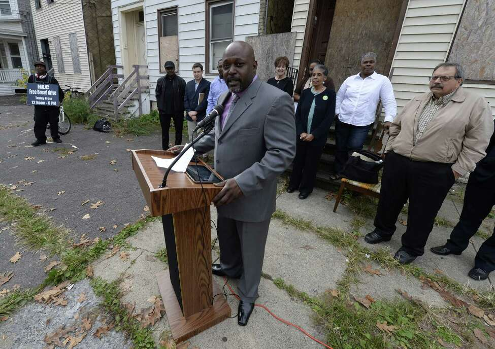 Sam Coleman received endorsements from local elected officials this morning Oct. 16, 2013 before he spoke in front of three derelict houses on Third St. in Albany, N.Y. (Skip Dickstein/Times Union)