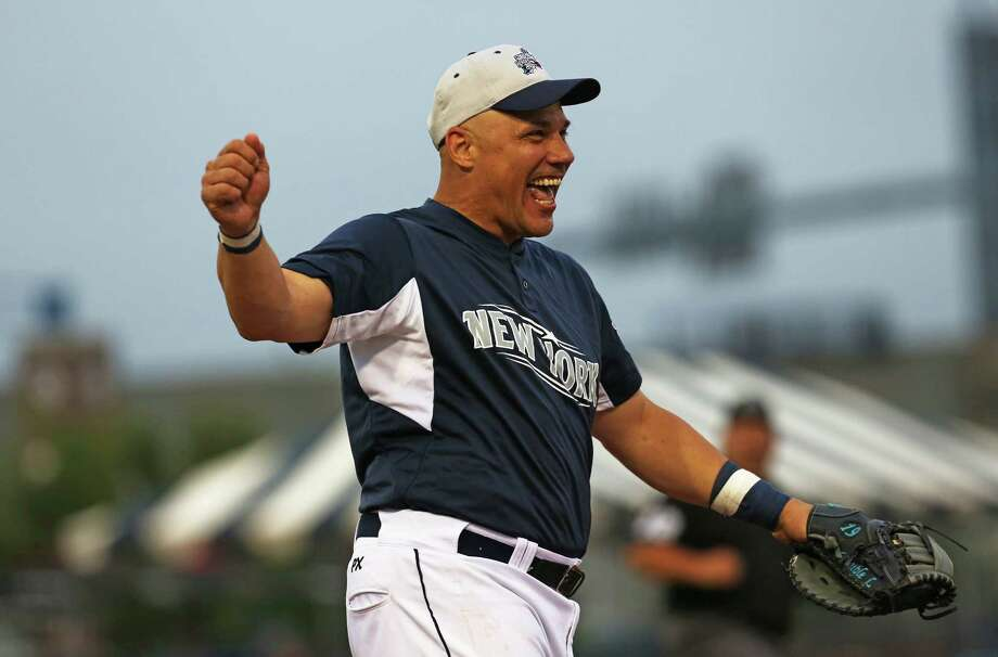 Former Yankees Jim Leyritz celebrates after making the out on a runner from the throw of pitcher and former Yankee Dwight Gooden during yesterday evening Legends game vs former Red Sox at Harbor Yard in Bridgeport on Thursday July 9, 2015. Photo: Mike Ross / For Hearst Connecticut Media / Connecticut Post Freelance