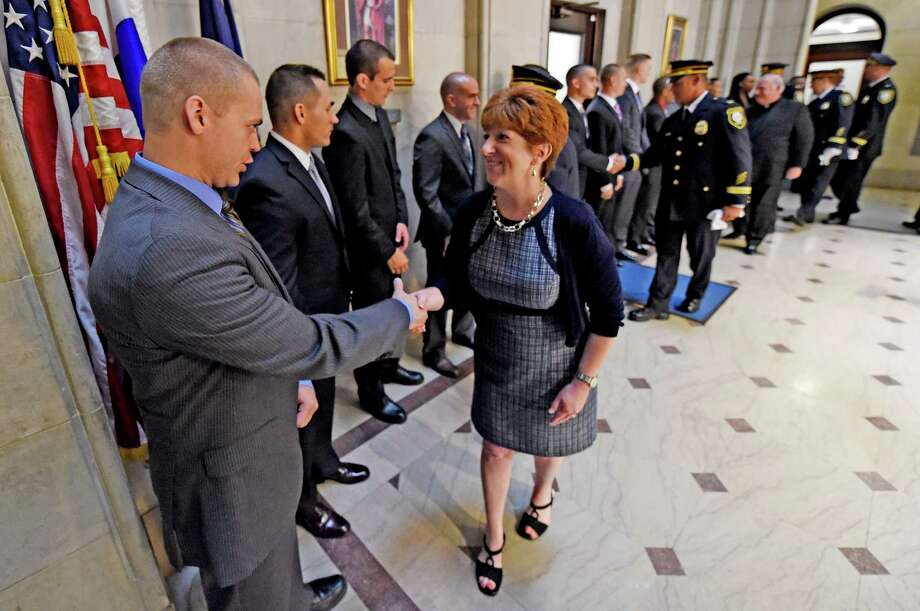 Albany Mayor Kathy Sheehan, right welcomes every member of the new class of 15 recruits for the Albany Police Department Thursday morning July 9, 2015 at City Hall in Albany, N.Y.     (Skip Dickstein/Times Union) Photo: SKIP DICKSTEIN / 00032555A