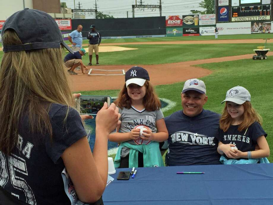 Julie Swindon of Naugatuck photographs her daughters, 8-year-old Kaitlyn, left, and 6-year-old Mallory, with ex-Yankees catcher Jim Leyritz. Former players from the Yankees and Red Sox were in Bridgeport on Thursday, July 9, 2015, for a charity game. Photo: Brian Koonz / Hearst Connecticut Media / Connecticut Post