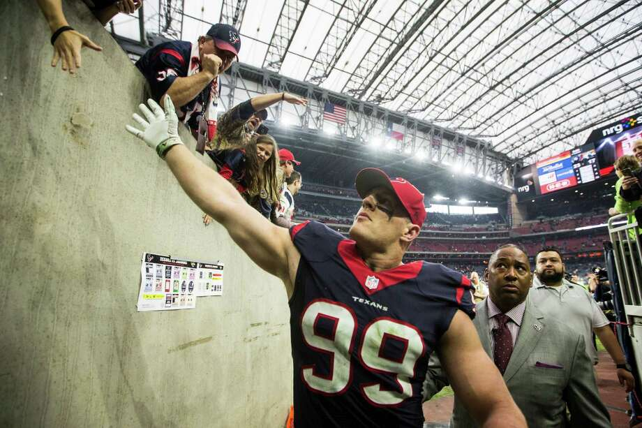 Texans defensive end J.J. Watt is not only a fan favorite, but his peers in the NFL respect his work enough to vote him the league's top player. Photo: Brett Coomer, Staff / © 2014  Houston Chronicle