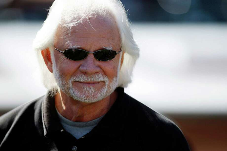 FILE - In this Sunday, Oct. 25, 2009 file photo, former Oakland Raiders quarterback Ken Stabler watches before an NFL football game between the New York Jets and the Oakland Raiders in Oakland, Calif. Stabler, who led the Raiders to a Super Bowl victory and was the NFL's Most Valuable Player in 1974, has died as a result of complications from colon cancer. He was 69. His family announced his death on Stabler's Facebook page on Thursday, July 9, 2015.  (AP Photo/Ben Margot, File) ORG XMIT: NY173 Photo: Ben Margot / AP