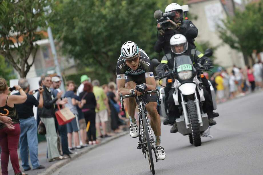 Stage winner Germany's Tony Martin breaks away in the last kilometers of the fourth stage of the Tour de France cycling race over 223.5 kilometers (138.9 miles) with start in Seraing, Belgium, and finish in Cambrai, France, Tuesday, July 7, 2015. (AP Photo/Laurent Cipriani) ORG XMIT: PDJ144 Photo: Laurent Cipriani / AP