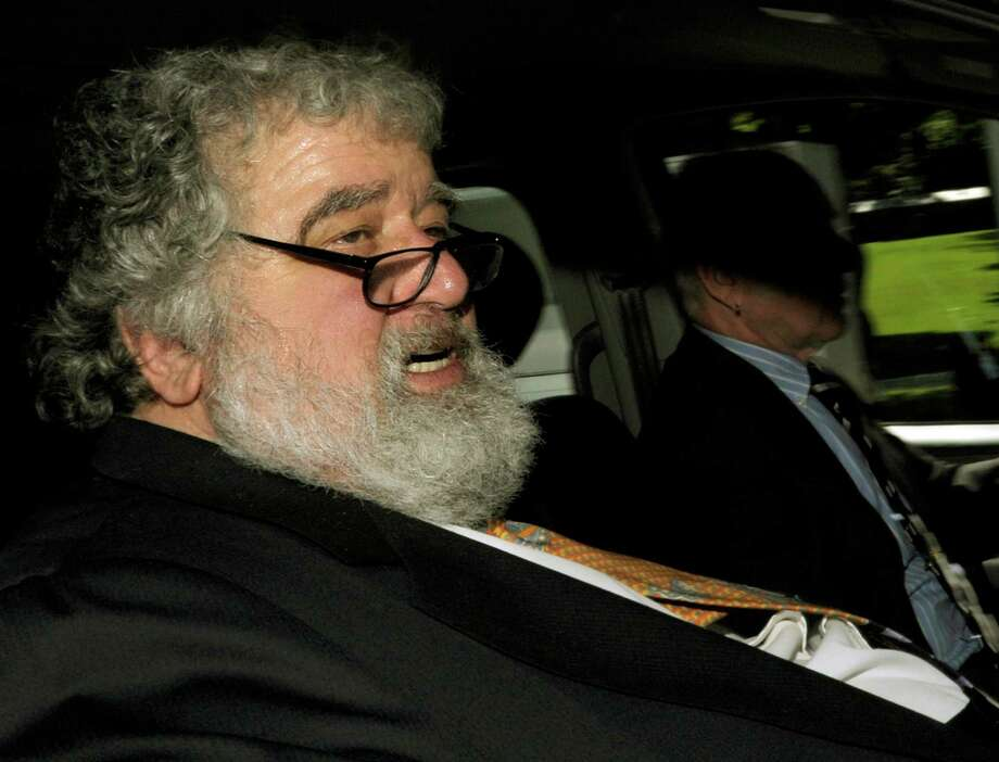 FILE - In this May 29, 2011 file photo FIFA official Chuck Blazer leaves the FIFA headquarters in Zurich, Switzerland. As it was announced Thursday, July 9, 2015 FIFA's ethics committee has expelled former executive committee member Blazer from football for bribery and other corruption. (Steffen Schmidt/Keystone via AP, File) ORG XMIT: LGL101 Photo: Steffen Schmidt / AP2011