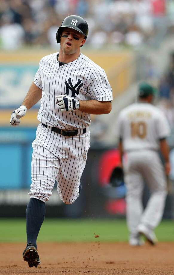 New York Yankees' Brett Gardner runs on his first-inning solo home run in a baseball game against the Oakland Atheltics at Yankee Stadium in New York, Thursday, July 9, 2015.  (AP Photo/Kathy Willens) ORG XMIT: NYY106 Photo: Kathy Willens / AP