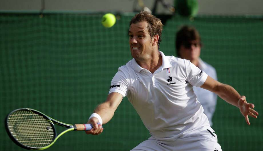 Richard Gasquet of France returns a shot to  Stan Wawrinka of Switzerland during the men's quarterfinal singles match at the All England Lawn Tennis Championships in Wimbledon, London, Wednesday July 8, 2015. (AP Photo/Pavel Golovkin) ORG XMIT: WIM316 Photo: Pavel Golovkin / AP