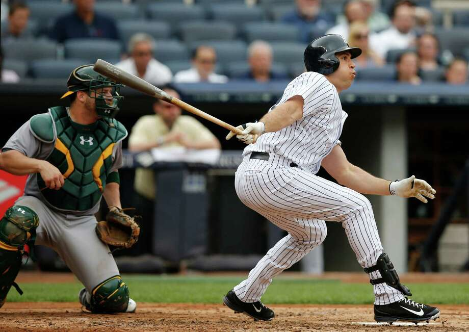 New York Yankees designated hitter Mark Teixeira hits a third-inning, RBI single in a baseball game against the Oakland Athletics at Yankee Stadium in New York, Thursday, July 9, 2015.  (AP Photo/Kathy Willens) ORG XMIT: NYY107 Photo: Kathy Willens / AP