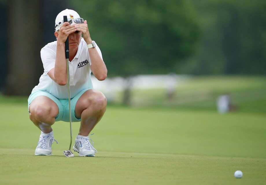 Karrie Webb of Australia lines up a putt on the ninth hole during the first round of the U.S. Women's Open golf tournament at Lancaster Country Club, Thursday, July 9, 2015 in Lancaster, Pa. (AP Photo/Gene J. Puskar) ORG XMIT: USO137 Photo: Gene J. Puskar / AP
