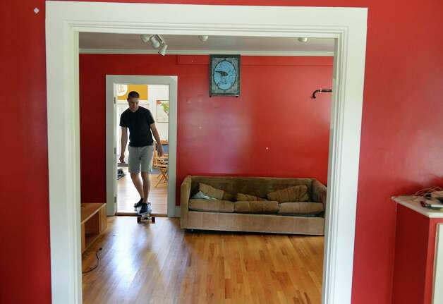 Ant Hill's front end designer Shane Bolland skate boards through the sales office of their Hacker House, where young entrepreneurs live and work Thursday July 2, 2015 in Saratoga Springs, NY.  (John Carl D'Annibale / Times Union) Photo: John Carl D'Annibale / 00032445A